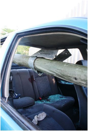 6 metre wooden pole wedged through car in serious accident