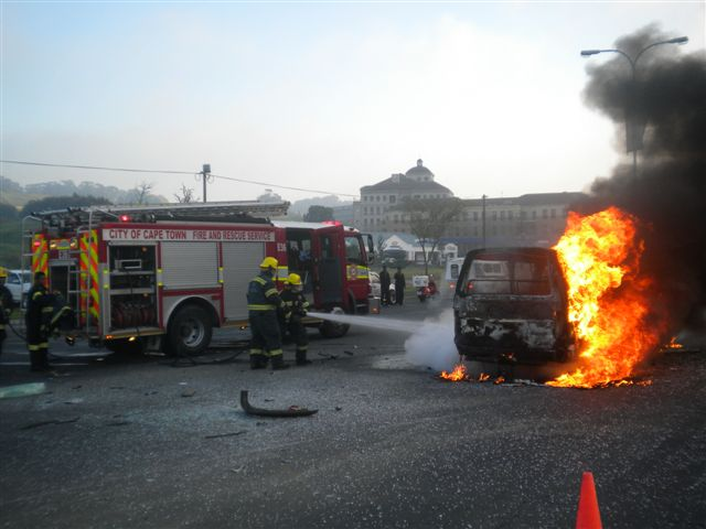 Taxi Bursts Into Flames After Collision