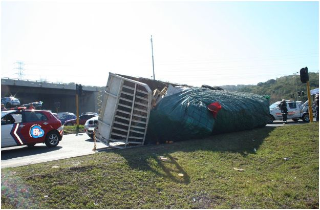 Truck overturns and Loses Cargo