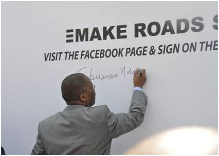 Minister Sibusiso Ndebele signs the Pledge Wall 10 September 2010