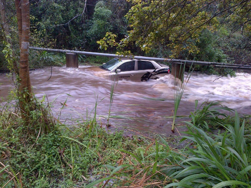 Cars Washed Away In Waterfall