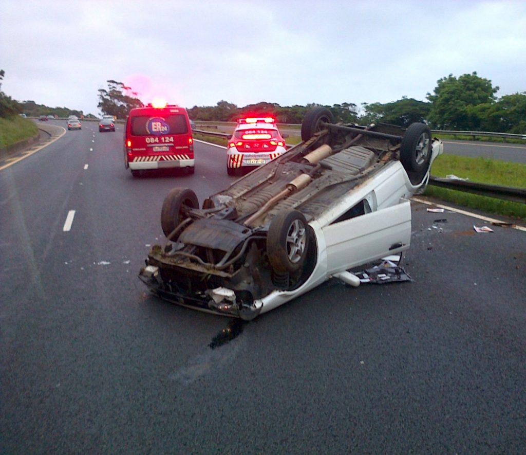 Woman injured after bakkie rolls and crashes into her car