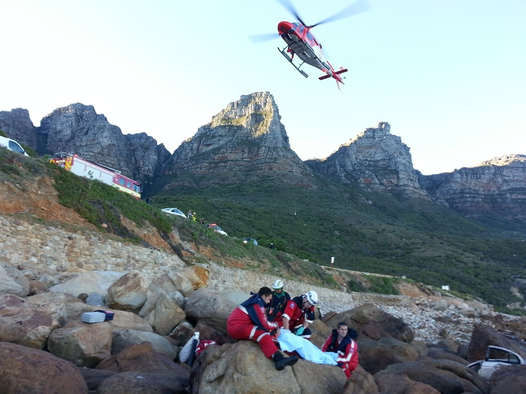 Car rolls down embankment at Camps Bay