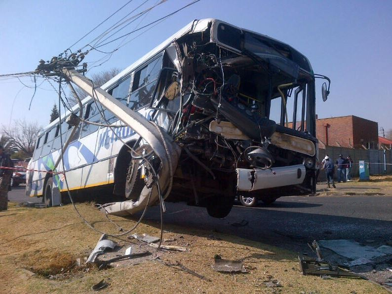 Bus and taxi collide head on in Reagent Park