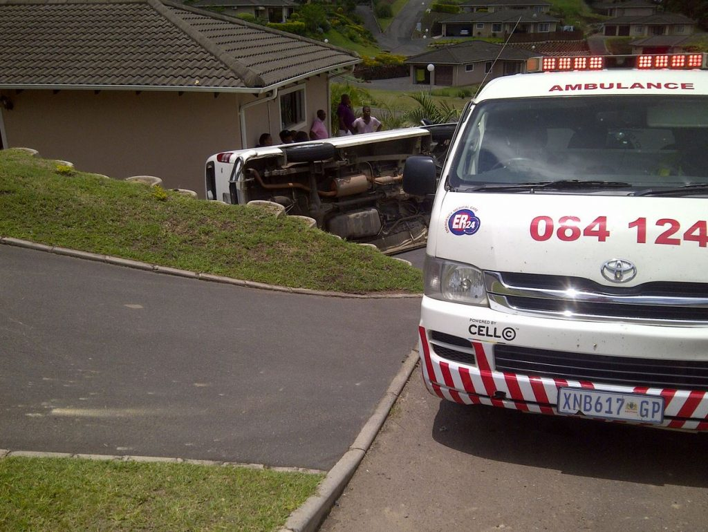 Taxi overturns in residential complex