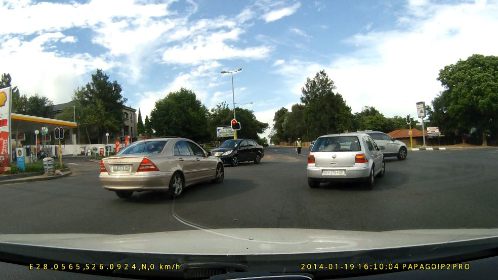 Do not tailgate and force through the traffic lights at the congested intersection!!