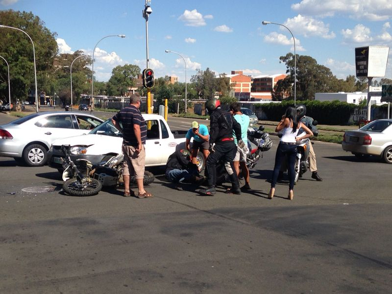 Photos from intersection collision as driver of bakkie skips traffic light and collides with bike in Bloemfontein