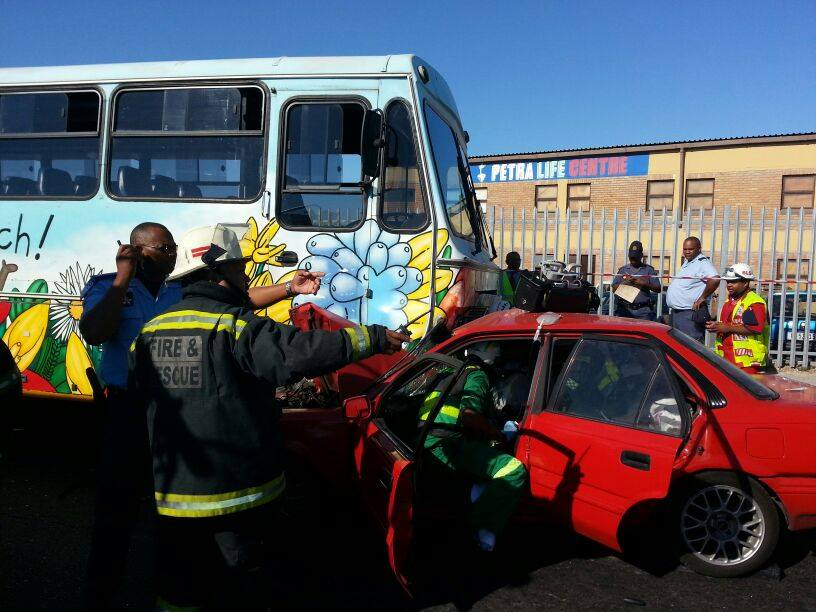 Jaws of life used to free victim after bus and car collides in Mitchells Plain