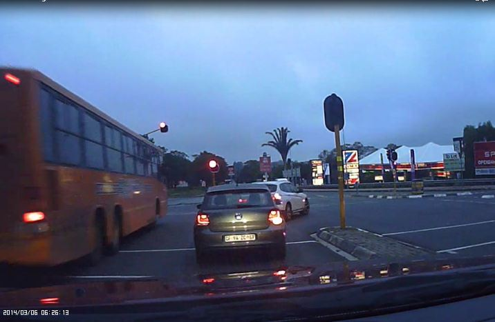 Dashboard camera captures bus accelerating through red light in Morningside