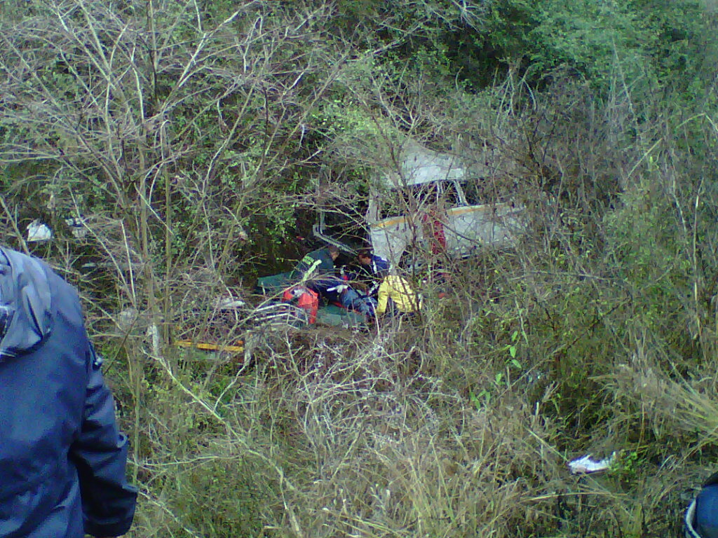 KZN R56 minibus rollover down embankment leaves two dead and seventeen injured