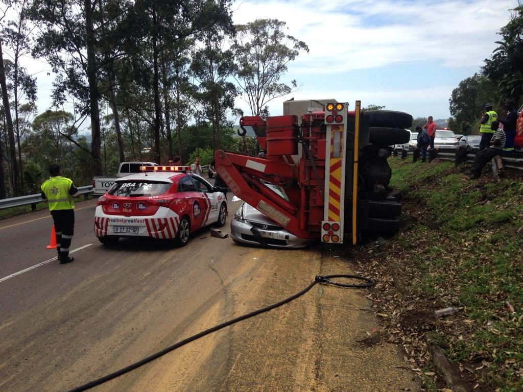 Truck crushes car, killing woman (2)