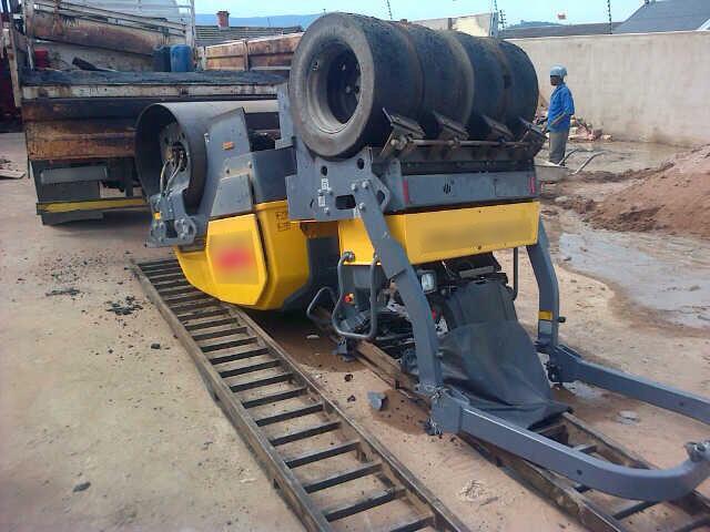 Lucky escape for construction worker when an asphalt roller flipped backwards