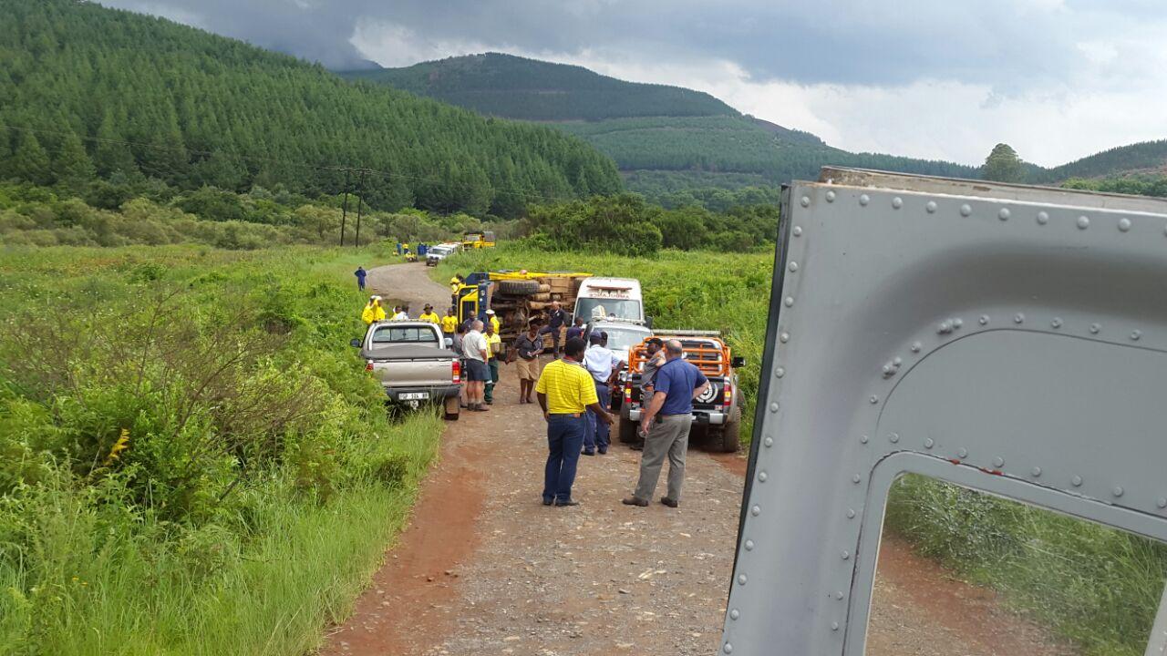 Truck rolls injuring 11