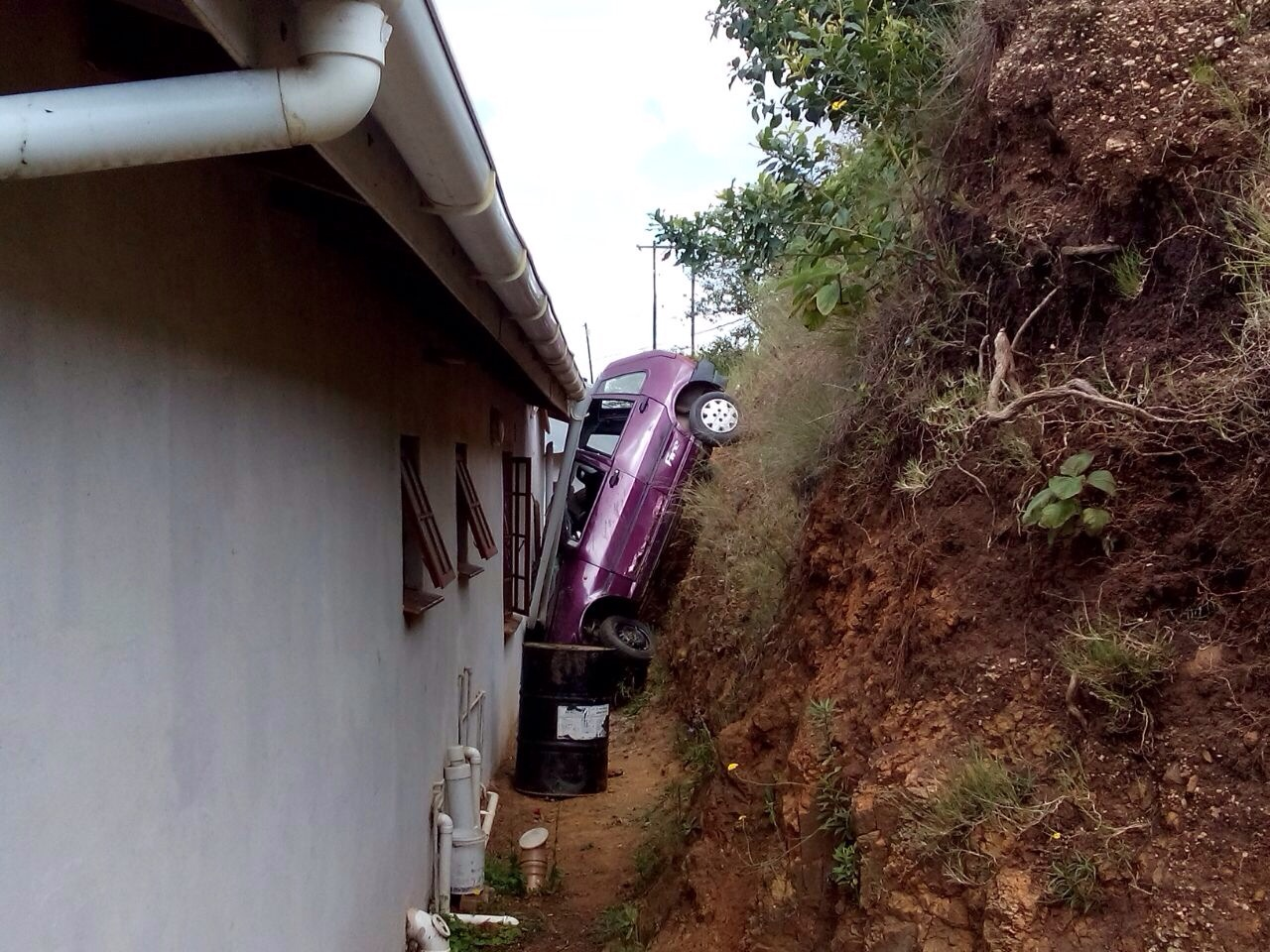 Man injured after vehicle lands between house and embankment