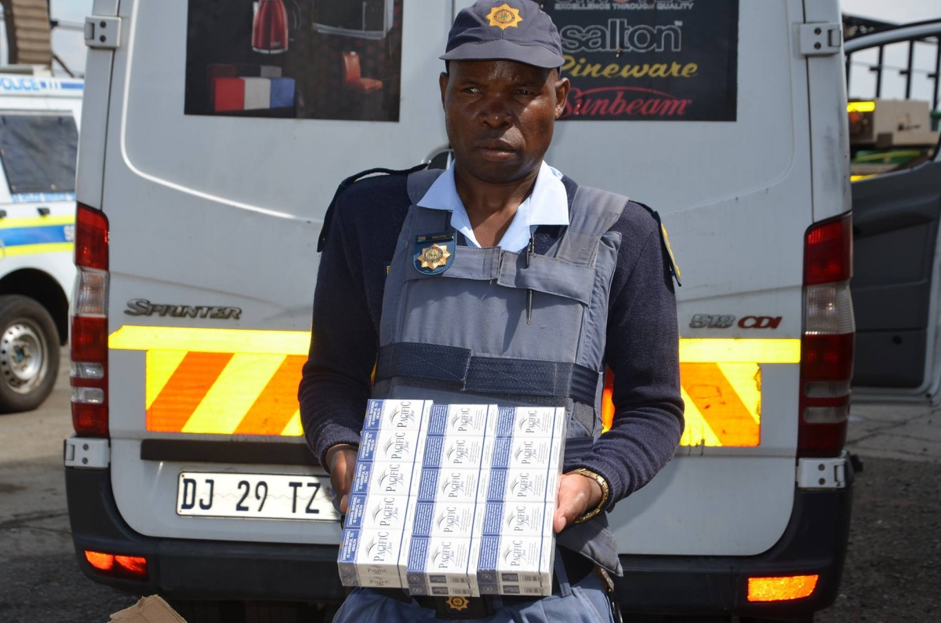 Police recover illicit cigarettes hidden in transported cargo of bananas on truck