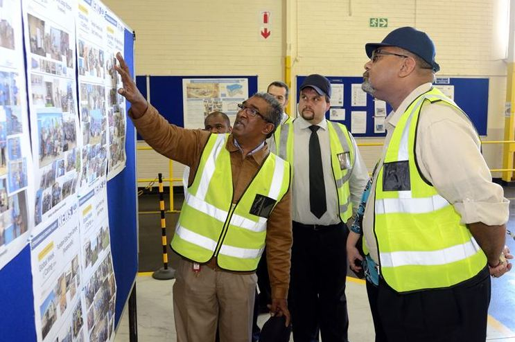Basil Raman, Operations Manager of the Ford Struandale Engine Plant (left) and John Cameron, Plant Manager (middle), discuss some of the local community projects undertaken by the employees with US Consul General Teddy Taylor during a tour of the Struandale Engine Plant.