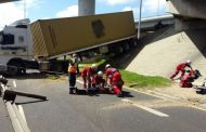 Two injured after truck drives off bridge