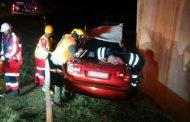 Car drives off bridge injuring two