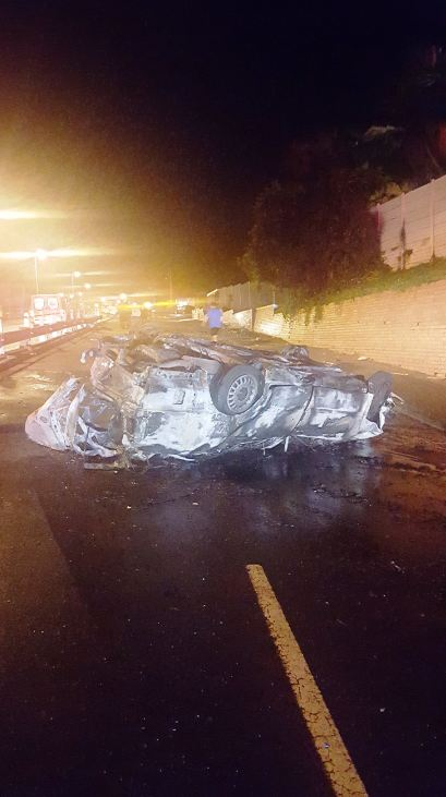 Car collides with a light pole and a wall and then the vehicle burst into flames