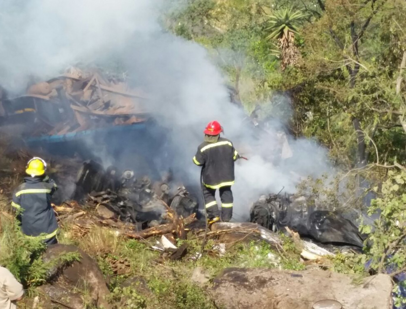 Three dead after truck rolls and catches alight in Barberton