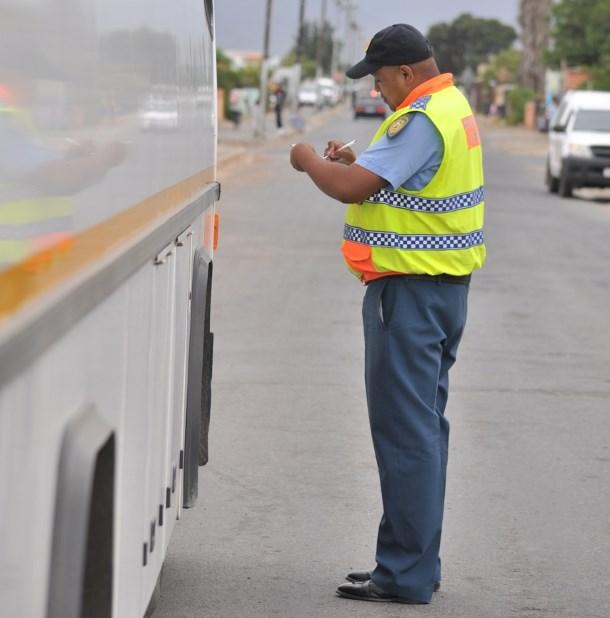 Traffic officer Jerome Kriel inspects a bus