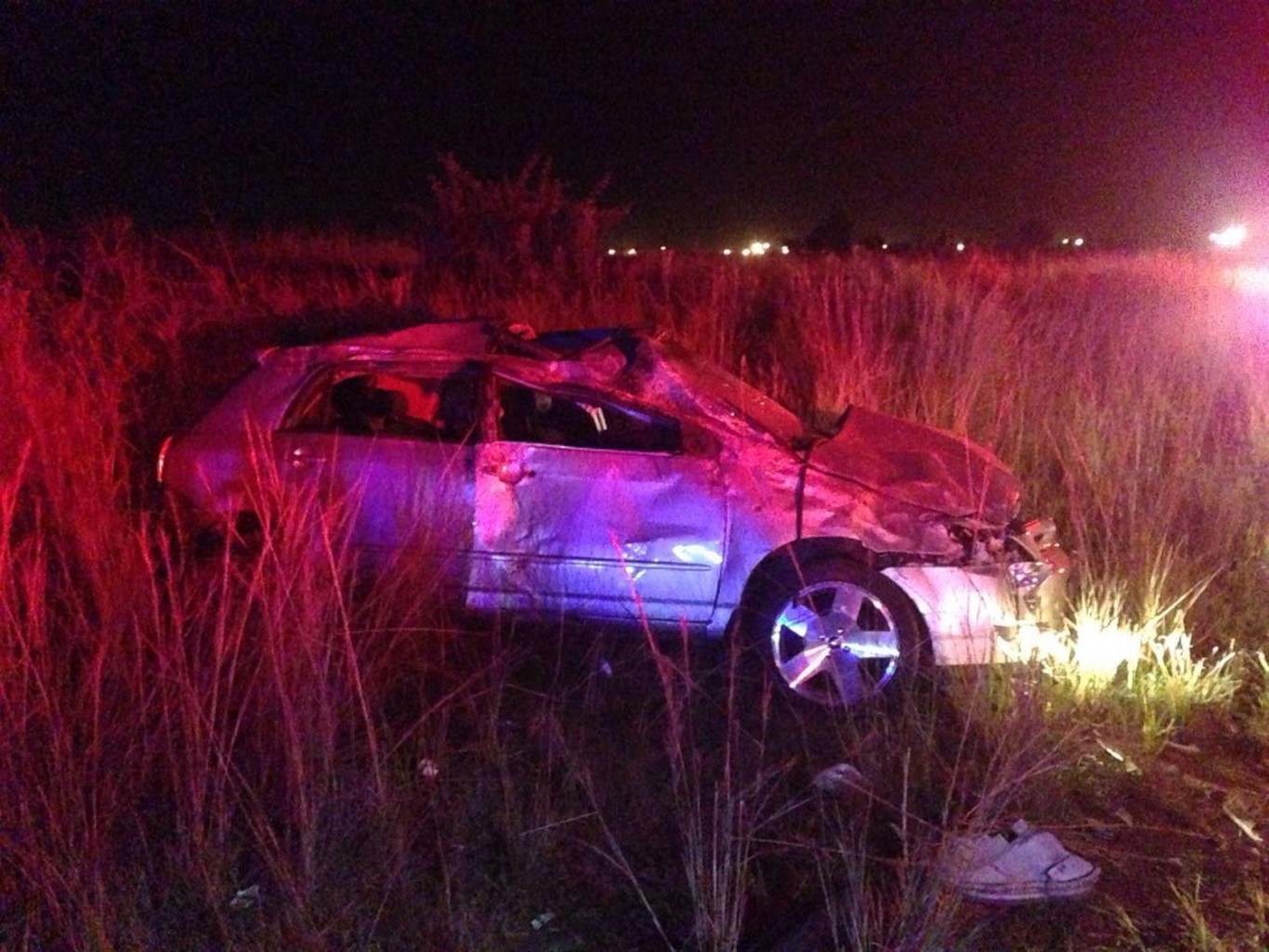 One dead, four injured after vehicle rolls