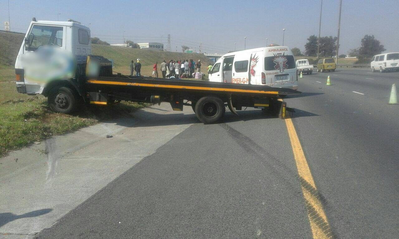 Three injured when taxi is rear-ended into flat bed truck in Alberton