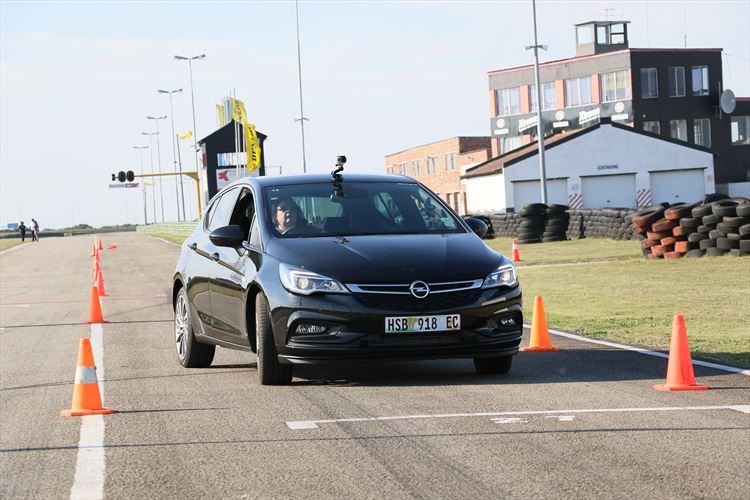 Yolanda Kotze, GMSA Global Compensation Consultant navigates the new Opel Astra through a set of cones at the Aldo Scribante Raceway.