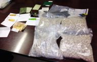 Suspect arrested for dealing in drugs and the possession of an unlicensed firearms.